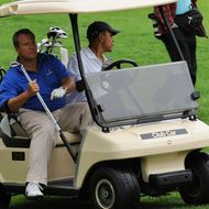 US President Barack Obama drives a golf cart with Robert Wolf sitting next to him as he plays golf at Mink Meadows Golf Club in Vineyard Haven on Martha's Vineyard, Massachusetts, on August 25, 2010. The US First Family is vacationing on the Island till August 29. AFP PHOTO/Jewel Samad (Photo credit should read JEWEL SAMAD/AFP/Getty Images)