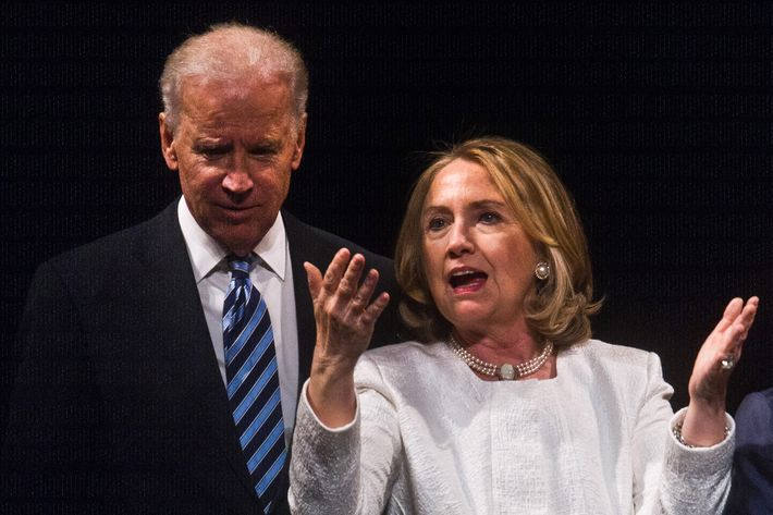 """Former US Secretary of State Hillary Clinton and Vice President Joe Biden speak at the end of the Vital Voices Global Awards ceremony at the Kennedy Center in Washington on April 2, 2013. The event honors """"women leaders from around the world who are the unsung heroines to strengthen democracy, increase economic opportunity, and protect human rights,"""" according to the group's website."""