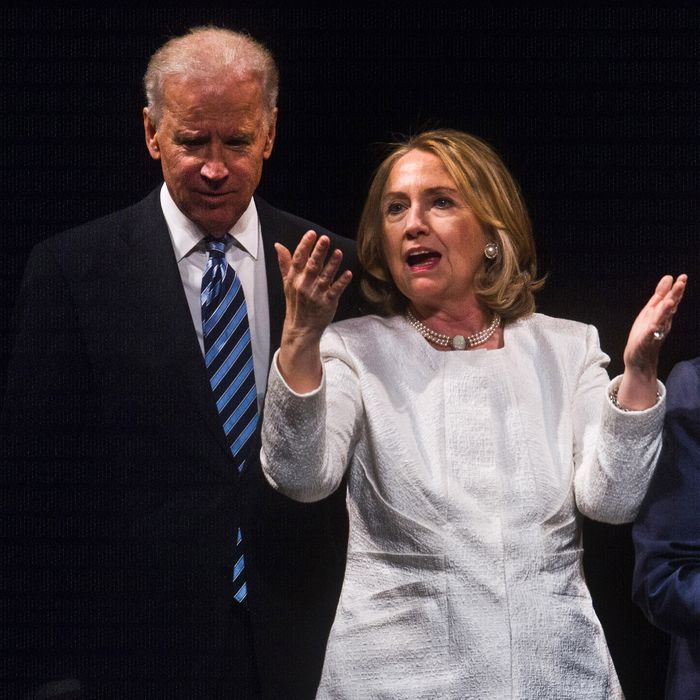 Former US Secretary of State Hillary Clinton and Vice President Joe Biden speak at the end of the Vital Voices Global Awards ceremony at the Kennedy Center in Washington on April 2, 2013. The event honors