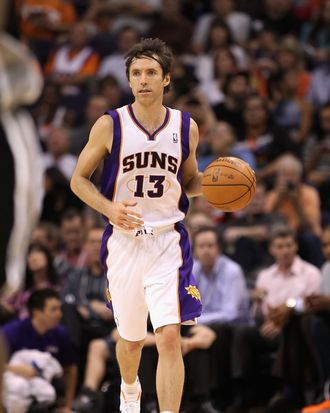 Steve Nash #13 of the Phoenix Suns moves the ball upcourt during the NBA game against the San Antonio Spurs at US Airways Center on April 25, 2012 in Phoenix, Arizona. The Spurs defeated the Suns 110-106.