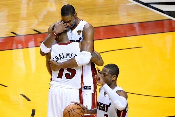 MIAMI, FL - JUNE 19:  (L-R) Mario Chalmers #15, Chris Bosh #1 and Dwyane Wade #3 of the Miami Heat celebrate after they won 104-98 against the Oklahoma City Thunder in Game Four of the 2012 NBA Finals on June 19, 2012 at American Airlines Arena in Miami, Florida. NOTE TO USER: User expressly acknowledges and agrees that, by downloading and or using this photograph, User is consenting to the terms and conditions of the Getty Images License Agreement.  (Photo by Ronald Martinez/Getty Images)