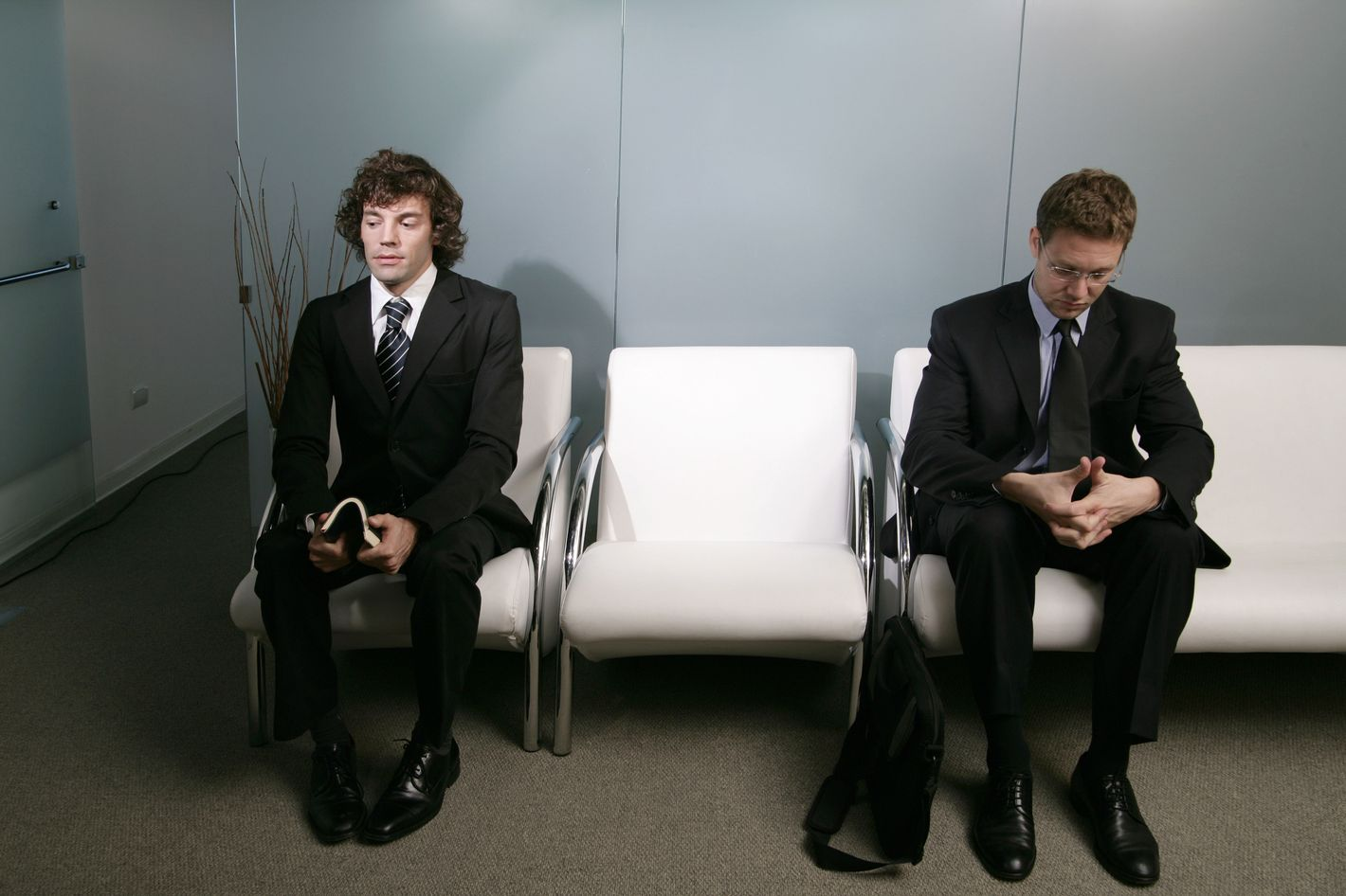 Businessmen Waiting in Lobby
