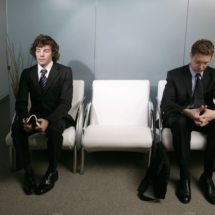 Businessmen Waiting in Lobby