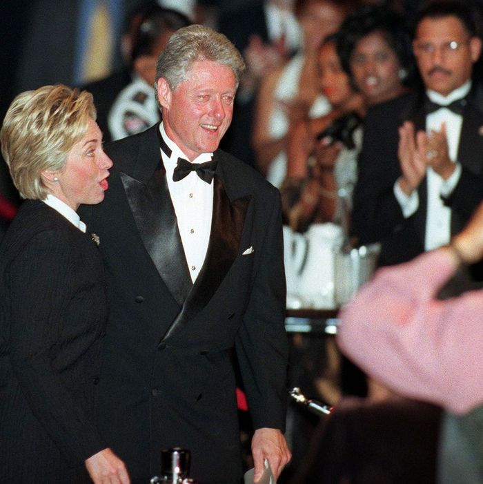 US President Bill Clinton and his wife Hillary are given an applause by the crowd after Clinton delivered his speech at the Congressional Black Caucus Foundation awards dinner 18 September, 1999 in Washington, DC.