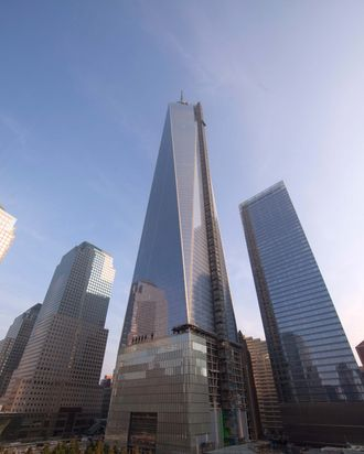 One World Trade Center looms over the north reflecting pool at the 9/11 Memorial during ceremonies for the 12th anniversary of the terrorist attacks on lower Manhattan at the World Trade Center site on September 11, 2013 in New York City.
