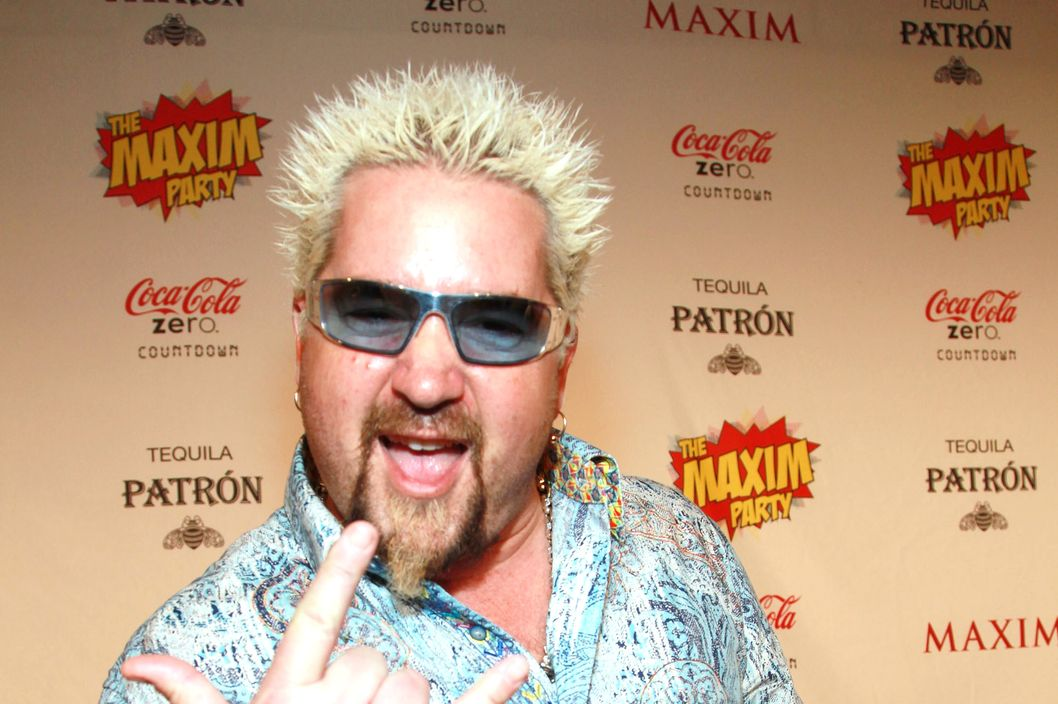 TV personality Guy Fieri attends Tabasco Buffalo Style Sauce At The Maxim Party at Indiana State Fairgrounds on February 4, 2012 in Indianapolis, Indiana.