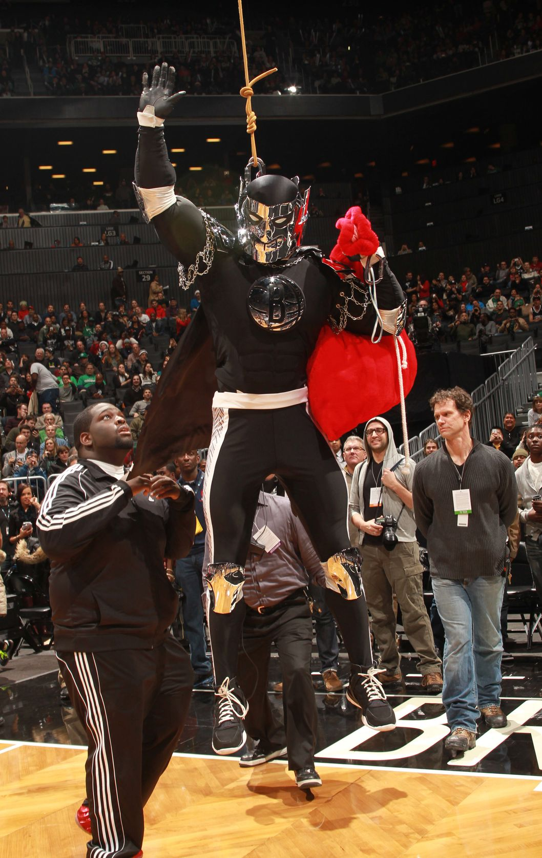 BROOKLYN, NY - DECEMBER 25:  The Brooklyn Knight of the Brooklyn Nets takes the court before the game against the Boston Celtics on December 25, 2012 at the Barclays Center in Brooklyn, New York. NOTE TO USER: User expressly acknowledges and agrees that, by downloading and or using this photograph, User is consenting to the terms and conditions of the Getty Images License Agreement. Mandatory Copyright Notice: Copyright 2012 NBAE (Photo by Ray Amati/NBAE via Getty Images)