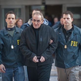 Jan. 23, 2014 - Manhattan, New York, U.S. - VINCENT ASARO, an alleged captain in the Bonanno crime family, is led from Federal Plaza as he is charged in connection with the 1978 Lufthansa heist at JFK International Airport; he was arrested for murder, racketeering, extortion, arson, robbery and other charges, Thursday, January 23, 2014. Asaro is one of five alleged members of the crime family arrested Thursday morning in the New York area by FBI agents.