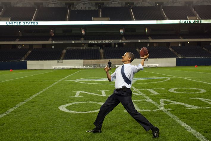 President Barack Obama throws a football on the field at Soldier Field following the NATO working dinner in Chicago, Illinois, May 20, 2012.