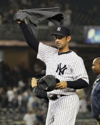 Jorge Posada #20 of the New York Yankees celebrates after clinching the American League East division against the Tampa Bay Rays on September 21, 2011.