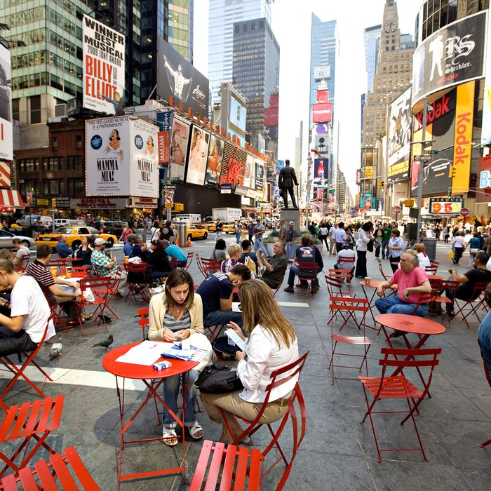 People sit at tables in Times Square in New York, U.S., on T