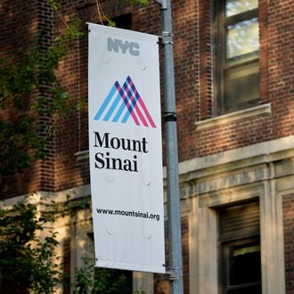 A sign outside Mount Sinai Hospital August 4, 2014 in New York after officials announced a male patient who recently traveled to West Africa is being tested for the ebola virus. AFP PHOTO/Stan HONDA (Photo credit should read STAN HONDA/AFP/Getty Images)