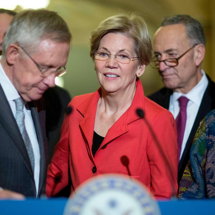 Senate Majority Leader Harry Reid, a Democrat from Nevada, from left, Senator Elizabeth Warren, a Democrat from Massachusetts, Senator Charles Schumer, a Democrat from New York, and Senator Debbie Stabenow, a Democrat from Michigan, hold a news conference following a private meeting at the U.S. Capitol Building in Washington, D.C., U.S., on Thursday, Nov. 13, 2014.