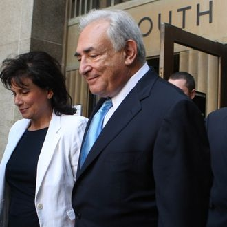 NEW YORK - JULY 1: Former International Monetary Fund leader Dominique Strauss-Kahn (C) and his wife Anne Sinclair (2nd L) leave New York State Supreme Court for a hearing July 1, 2011 in New York City. The Manhattan district attorney's office agreed to release Strauss-Kahn without bail after the credibility of the alleged sexual assault victim had come into question. Strauss-Kahn was arrested on May 14 on sexual assault charges stemming from an incident in a New York hotel. (Photo by Daniel Barry/Getty Images)