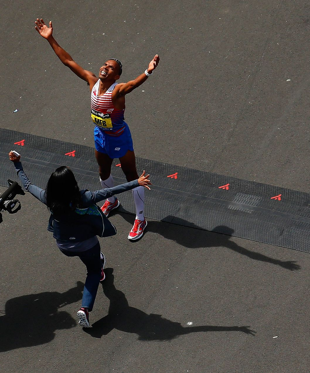 BOSTON, MA - APRIL 21:  Meb Keflezighi of the United States reacts after coming in first place in the 2014 B.A.A. Boston Marathon on April 21, 2014 in Boston, Massachusetts. Meb becomes the first American winner of the Boston Marathon since 1983. Today marks the 118th Boston Marathon; security presence has been increased this year, due to two bombs that were detonated at the finish line last year, killing three people and injuring more than 260 others.  (Photo by Jared Wickerham/Getty Images)