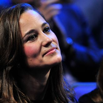 Pippa Middleton, sister of Catherine, Duchess of Cambridge, watches Jo-Wilfried Tsonga of France play against Roger Federer of Switzerland during the singles final on day eight of the ATP World Tour Finals tennis tournament in London on November 27, 2011. Roger Federer won a record sixth ATP World Tour Finals title with a 6-3, 6-7 (6/8), 6-3 victory over France's Jo-Wilfried Tsonga on Sunday. With this win he moved ahead of Pete Sampras and Ivan Lendl on the list of Tour Finals champions in the 100th final of his majestic career. The 30-year-old, who retains the title he won 12 months ago, has now won 70 trophies in his career and has also equalled Lendl's record of 39 match wins in the end-of-season event. AFP PHOTO / GLYN KIRK (Photo credit should read GLYN KIRK/AFP/Getty Images)