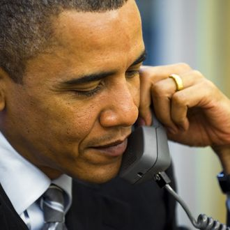 US President Barak Obama speaks on the phone with new British Prime Minister David Cameron at the White House in Washington, DC, May 11, 2010, minutes after the Conservative Party leader took up his duties at 10 Downing Street. AFP PHOTO/Jim WATSON (Photo credit should read JIM WATSON/AFP/Getty Images)