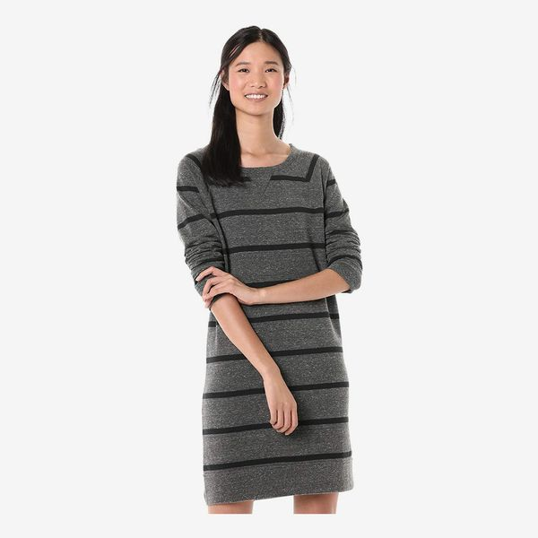 A model wearing the grey and black horizontally striped Goodthreads Women's Modal Fleece Popover Sweatshirt Dress with the long sleeves pushed up. 33 Things on Sale You'll Actually Want to Buy: From Adidas to Le Creuset - The Strategis