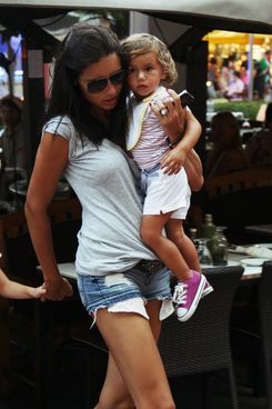 Adriana Lima carries her daughter, Valentina into a building during a Summer rain storm in Miami Beach, FL. <P> Pictured: Adriana Lima and Valentina Jaric <P> <B>Ref: SPL303430  030811  </B><BR/> Picture by: Pichichi / Splash News<BR/> </P><P> <B>Splash News and Pictures</B><BR/> Los Angeles:310-821-2666<BR/> New York:212-619-2666<BR/> London:870-934-2666<BR/> photodesk@splashnews.com<BR/> </P>