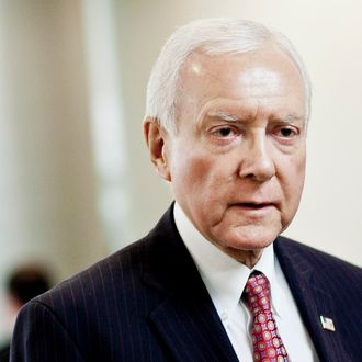 WASHINGTON, DC - MARCH 20: U.S. Sen. Orrin Hatch (R-UT) heads to a weekly policy meeting at the Capitol on March 20, 2012 in Washington, DC. The stage is being set for a fresh budget battle after the House GOP's plan was announced today amid calls from Democrats that their plan is already in place in the form of last year's Budget Control Act. (Photo by T.J. Kirkpatrick/Getty Images)