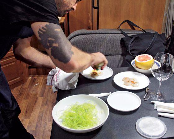 Mattos preparing the dinner, from RV to dumbwaiter.