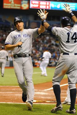 ST. PETERSBURG, FL - JULY 4:  Infielder Mark Teixeira #25 of the New York Yankees and outfielder Curtis Granderon #14 celebrate after scoring two runs in the eighth inning against the Tampa Bay Rays July 4, 2012 at Tropicana Field in St. Petersburg, Florida.  Infielder Robinson Cano #24 singled to drive in the runs.  The Yankees won 4 - 3. (Photo by Al Messerschmidt/Getty Images)