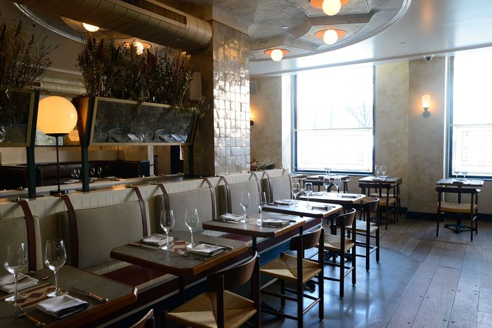 If you dine out a lot, you might recognize the stylistic touches of Brooklyn's Home Studios. Concrete tabletops are inlaid with antique tile.