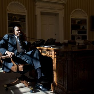 President Barack Obama talks on the phone with British Prime Minister David Cameron in the Oval Office, Feb. 13, 2012