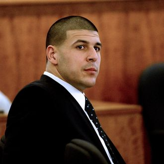 epa04694088 Former New England Patriots player Aaron Hernandez listens to testimony during his murder trial, at Bristol County Superior Court in Fall River, Massachusetts, USA, 06 April 2015. Hernandez is accused of the 2013 murder of Odin Lloyd. EPA/TED FITZGERALD / POOL
