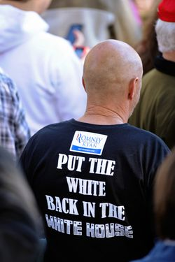 LANCASTER, OH - OCTOBER 12:  A supporter of Republican presidential candidate, former Massachusetts Gov. Mitt Romney and Republican vice presidential candidate U.S. Rep. Paul Ryan (R-WI) waits for a campaign event to begin on October 12, 2012 in Lancaster, Ohio. Ryan debated U.S. Vice President Joe Biden the evening before and Romney is scheduled to debate U.S. President Barack Obama for the second time on October 16.  (Photo by Jamie Sabau/Getty Images)