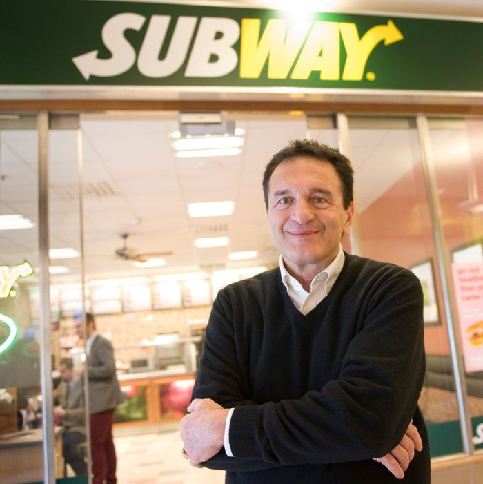 Fred DeLuca outside a Subway.