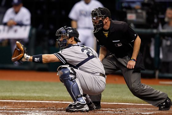 ST. PETERSBURG, FL - SEPTEMBER 15:  Catcher Jorge Posada #20 of the New York Yankees catches a homeplate umpire Lance Barksdale #67 looks on against the Tampa Bay Rays during the game at Tropicana Field on September 15, 2010 in St. Petersburg, Florida.  (Photo by J. Meric/Getty Images) *** Local Caption *** Jorge Posada;Lance Barksdale