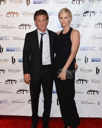 BEVERLY HILLS, CA - MARCH 02: Sean Penn and Charlize Theron attend the Fame and Philanthropy Post-Oscar Party at The Vineyard on March 2, 2014 in Beverly Hills, California. (Photo by Jason Kempin/Getty Images)