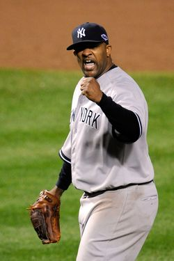 CC Sabathia #52 of the New York Yankees reacts after Mark Reynolds #12 of the Baltimore Orioles grounded out for the final out in the bottom of the eighth inning during Game One of the American League Division Series at Oriole Park at Camden Yards on October 7, 2012 in Baltimore, Maryland.