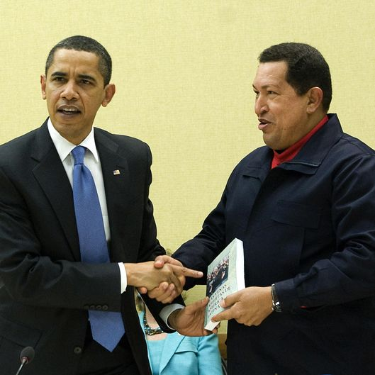 Venezuelan President Hugo Chavez (R) gives a book, 'The Open Viens of Latin America' of Uruguayan writer Eduardo Galeano to US President Barack Obama (L) during a multilateral meeting to begin during the Summit of the Americas at the Hyatt Regency in Port of Spain, Trinidad April 18, 2009.                   AFP  PHOTO/Jim WATSON (Photo credit should read JIM WATSON/AFP/Getty Images)