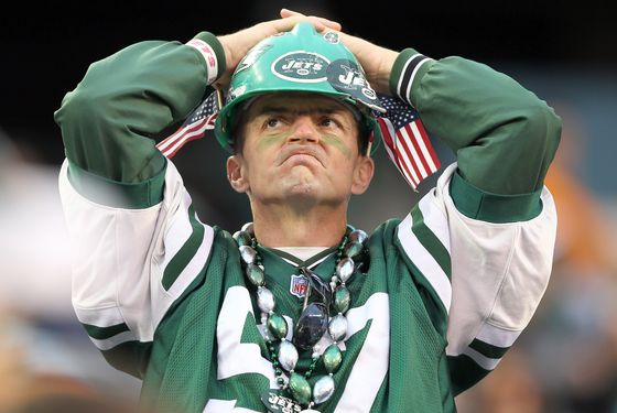 A New York Jets fans watches the final minutes of the game against the Miami Dolphins on October 28, 2012 at MetLife Stadium in East Rutherford, New Jersey.The Miami Dolphins defeated the New York Jets 30-9.