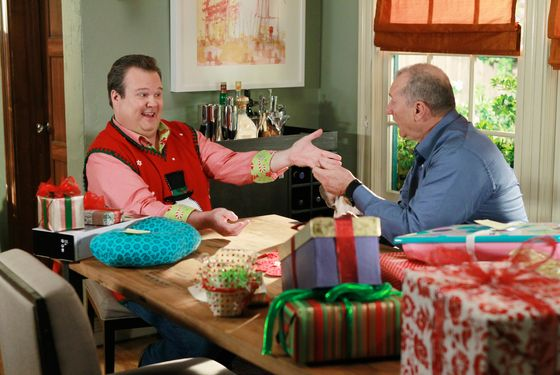 "MODERN FAMILY - ""Express Christmas"" - The family is gathered at Jay and Gloria's pool on a sunny December day, and that's where they realize that everyone will be scattered this coming Christmas, so if they want to celebrate together, then it will have to be today! Everyone sets off with their respective duties for Express Christmas - Mitchell, Alex and Lily get the tree, Jay and Cameron are in charge of gift wrapping, Phil and Manny get the groceries, Gloria and Luke go retrieve the ornaments, and Claire and Haley shop for all the gifts. When they all return in the evening, it's quite a sight, on ""Modern Family,"" WEDNESDAY, DECEMBER 7 (9:00-9:31 p.m., ET), on the ABC Television Network. (ABC/PETER ""HOPPER"" STONE) ERIC STONESTREET, ED O'NEILL"