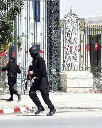 Tunisian security forces secure the area after gunmen attacked Tunis' famed Bardo Museum on March 18, 2015. At least seven foreigners and a Tunisian were killed in an attack by two men armed with assault rifles on the museum, the interior ministry said. AFP PHOTO / FETHI BELAID (Photo credit should read FETHI BELAID/AFP/Getty Images)