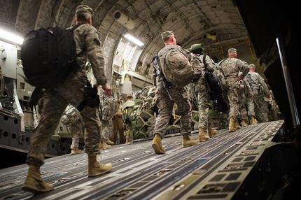 US soldiers board the last C17 aircraft carrying US troops out of Iraq at Camp Adder on the outskirts of the southern Iraqi city of Nasiriyah on December 17, 2011. From the tens of thousands killed and wounded to the hundreds of billions of dollars spent in eight years of conflict, the cost of the Iraq war is astronomic and still growing. AFP PHOTO/MARTIN BUREAU (Photo credit should read MARTIN BUREAU/AFP/Getty Images)