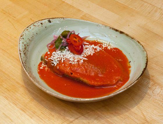 Chiles rellenos con hongos, queso fresco, raja, e salsa rojo.