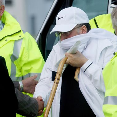 GLASGOW, SCOTLAND - AUGUST 20:  Lockerbie bomber Abdelbaset Ali al-Megrahi arrives at Glasgow airport to baord a plane after arriving from Greenock Prison on August 20, 2009 in Glasgow, Scotland. Abdelbaset ali al-Megrahi had been serving a life sentence for the 1988 Pan-AM flight 103 Lockerbie bombing, which killed 270 people. Megrahi, who is terminally ill with prostate cancer, served eight years of a life sentence and following today's decision, has been released on compassionate grounds to go home to spend his remaining days with his family in Libya.  (Photo by Danny Lawson - Pool/Getty Images) *** Local Caption *** Abdelbaset Ali al-Megrahi