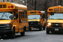 School buses idle in front of a school in Manhattan's East Village on January 15, 2013 in New York City. Drivers of the city's school buses are set to go on strike tomorrow after negotiations with Mayor Michael Bloomberg failed to reach an agreement; over 150,000 children will need to find an alternate method of transportation to school.NEW YORK, NY - JANUARY 15:  School buses idle in front of a school in Manhattan's East Village on January 15, 2013 in New York City. Drivers of the city's school buses are set to go on strike tomorrow after negotiations with Mayor Michael Bloomberg failed to reach an agreement; over 150,000 children will need to find an alternate method of transportation to school.  (Photo by Mario Tama/Getty Images)
