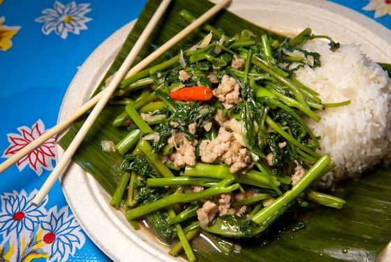 Water spinach stir-fried with pork, garlic, Thai chilies, preserved yellow beans, and oyster and fish sauces.