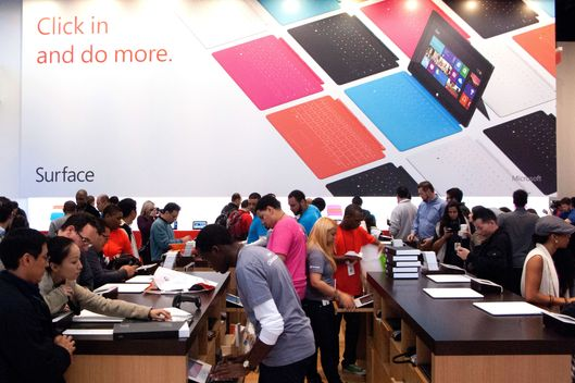 Customers get a look at products at Microsoft's pop-up store, set up on the corner of 46th Street in Times Square to mark the release of its Surface tablet, October 26, 2012 in New York. The store is one of more than 30 stores around the US showing off the Microsoft Surface and Microsoft's Windows 8.