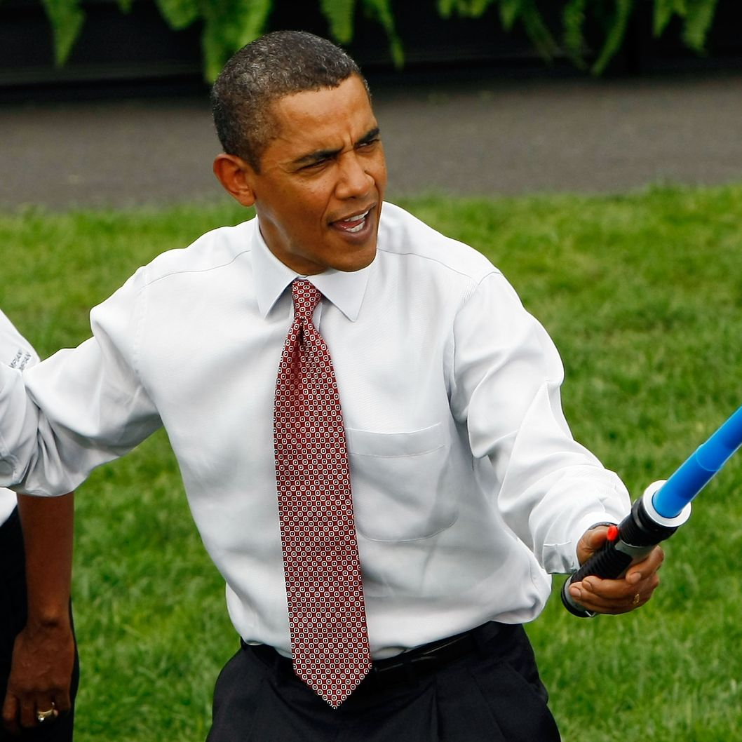 WASHINGTON - SEPTEMBER 16:  U.S. President Barack Obama jokingly attacks Olympic fencer Tim Morehouse during a fencing demonstration on the South Lawn of the White House promoting the city of Chicago's bid for the 2016 Summer Olympics September 16, 2009 in Washington, DC. Obama joined Chicago Mayor Richard Daley, members of the USOC, and representatives from the Chicago2016 group during the event.  (Photo by Win McNamee/Getty Images) *** Local Caption *** Barack Obama