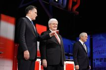 TAMPA, FL - JANUARY 23:  Republican presidential candidates, former Massachusetts Gov. Mitt Romney and former Speaker of the House Newt Gingrich (R-GA) interact while U.S. Rep. Ron Paul (R-TX) looks on prior to the NBC News, National Journal, Tampa Bay Times debate held at the University of South Florida on January 23, 2012 in Tampa, Florida. The debate is the first of two before the Florida primaries on January 31st.  (Photo by Chip Somodevilla/Getty Images)