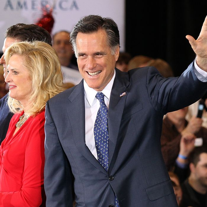 NOVI, MI - FEBRUARY 28: Republican presidential candidate and former Massachussetts Gov. Mitt Romney waves to supporters during a primary night gathering at the Suburban Collections Showplace on February 28, 2012 in Novi, Michigan. Romney was declared the winner of the Arizona and Michigan primaries. (Photo by Justin Sullivan/Getty Images)
