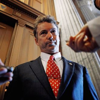 U.S. Sen. Rand Paul (R-KY) talks with reporters after he voted against a continuing resolution for the federal budget in the U.S. Captiol March 2, 2011 in Washington, DC