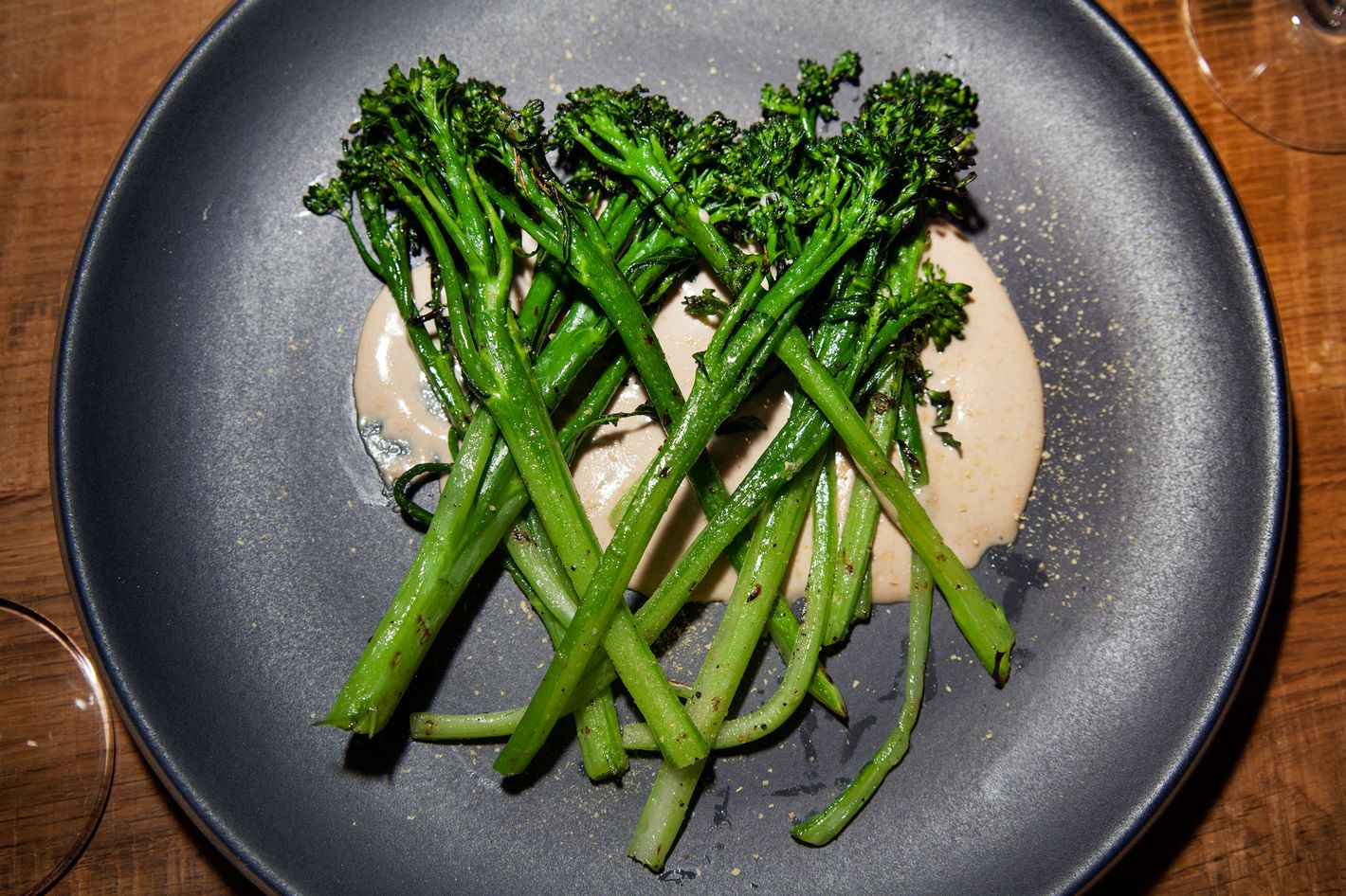 Charred broccolini tonnato gets dusted with nutritional yeast.