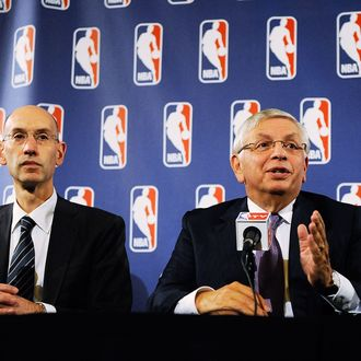 NEW YORK, NY - OCTOBER 04: Deputy Commissioner Adam Silver (L) looks on as NBA Commissioner David Stern speaks at a press conference after NBA labor negotiations at The Westin Times Square on October 4, 2011 in New York City. Stern announced the NBA has canceled the remainder of the preseason and will cancel the first two weeks of the regular season if there is no labor agreement by Monday. (Photo by Patrick McDermott/Getty Images)